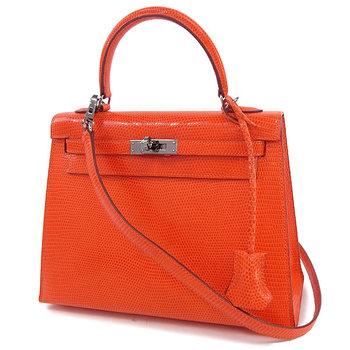 【エルメス ハンドバッグ ケリー 25 cm 外縫い オレンジ×ルテニウム金具 リザード】赤みのあるオレンジがチャーミング